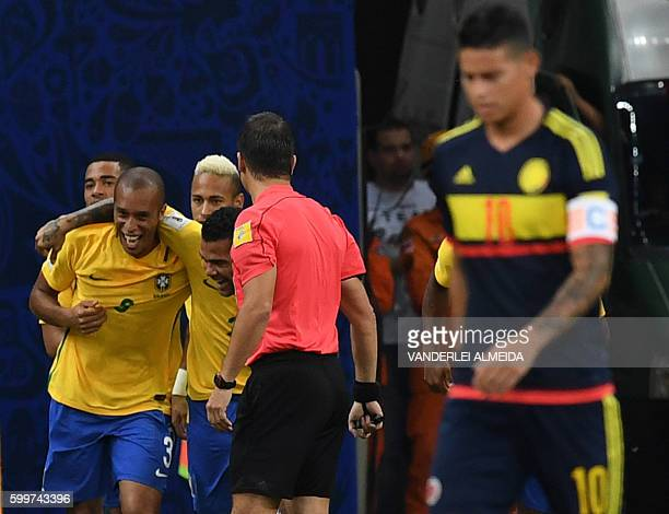Brazil's Miranda celebrates his goal after scoring against Colombia during their Russia 2018 FIFA World Cup football qualifier match Brazil vs...