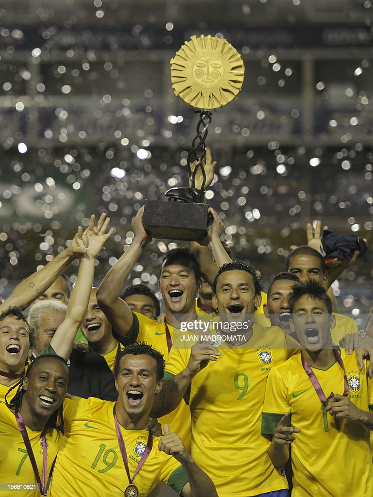 Brazil's national football team celebrates with the trophy after defeating Argentina in penalty shoot-out during a friendly football match at Bombonera stadium in Buenos Aires on November 21, 2012. AFP PHOTO / Juan Mabromata
