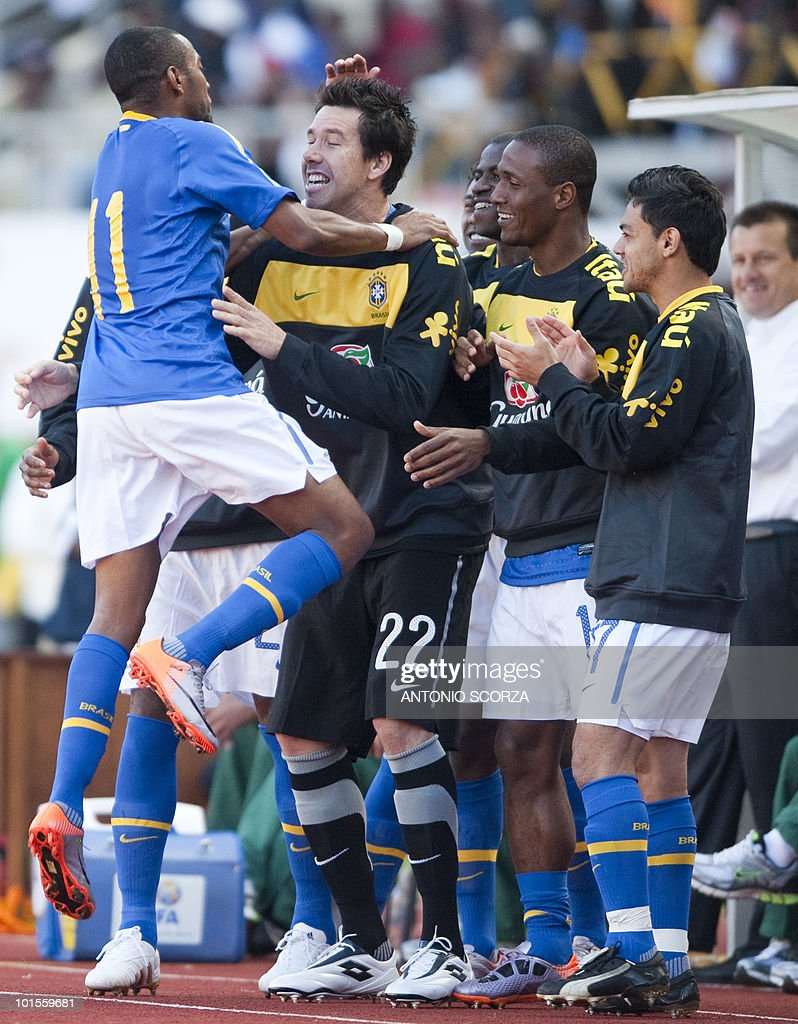 Brazil's national football team forward Robinho (L) celebrates with teammates his goal against Zimbabwe at the National Sport Stadium in Harare on June 2, 2010 during a friendly football match. The Brazilian national team is preparing for the 2010 FIFA World Cup in South Africa.