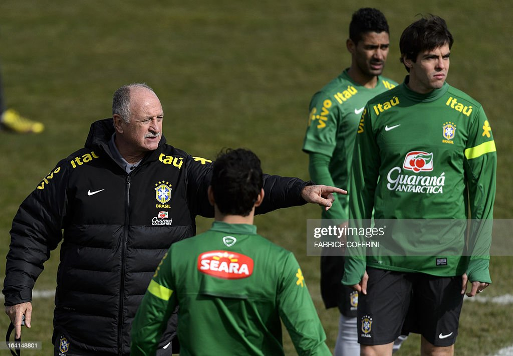 Brazil's national football team head coach Luiz Felipe Scolari (L) gestures next to Brazilian midfielder Kaka (R) during a training session on March 20, 2013 in Nyon, on the eve of a friendly football match against Italy in Geneva. The player behind Kaka is Antonio Marcos De Azevedo, a Brazilian player from the local FC Servette club.