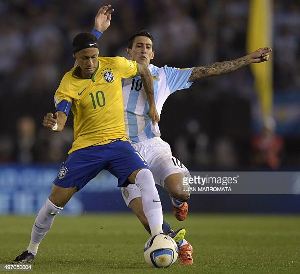 Brazil's Neymar and Argentina's Angel Di Maria vie during their Russia 2018 FIFA World Cup South American Qualifiers football match in Buenos Aires...