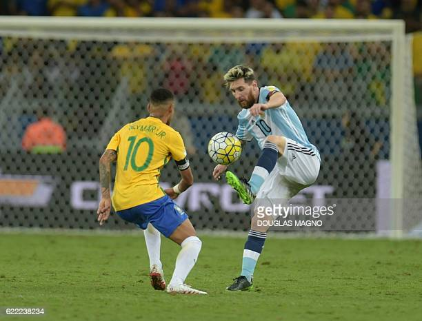 Brazil's Neymar and Argentina's Lionel Messi vie for the ball during their 2018 FIFA World Cup qualifier football match in Belo Horizonte Brazil on...