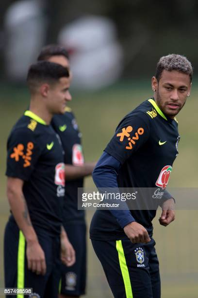 Brazil's Neymar and Philippe Coutinho take part in a training session of the national football team at the Granja Comary sports complex in...