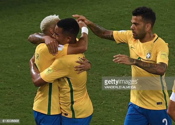Brazil's Neymar Brazil's Gabriel Jesus and Brazil's Dani Alves celebrate after scoring against Bolivia during their Russia 2018 World Cup qualifier...