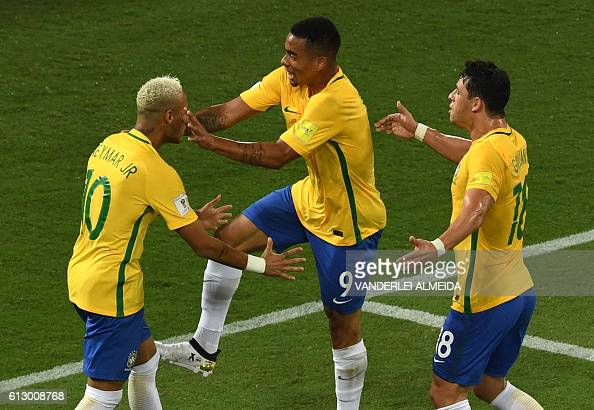 Brazil's Neymar Brazil's Gabriel Jesus and Brazil's Giuliano celebrate after scoring against Bolivia during their Russia 2018 World Cup qualifier...