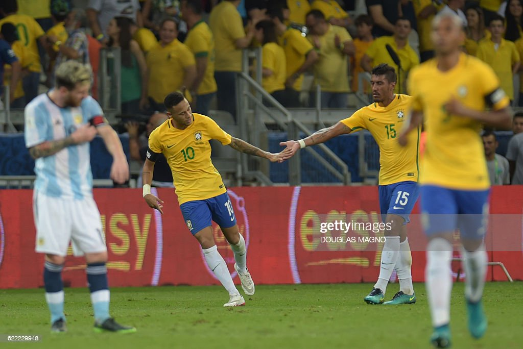 Brazil's Neymar (2-L) celebrates after scoring the team's second goal against Argentina during their 2018 FIFA World Cup qualifier football match in Belo Horizonte, Brazil, on November 10, 2016. / AFP /