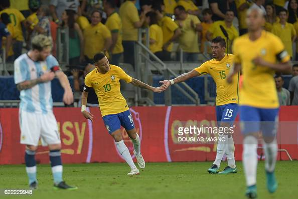 Brazil's Neymar celebrates after scoring the team's second goal against Argentina during their 2018 FIFA World Cup qualifier football match in Belo...