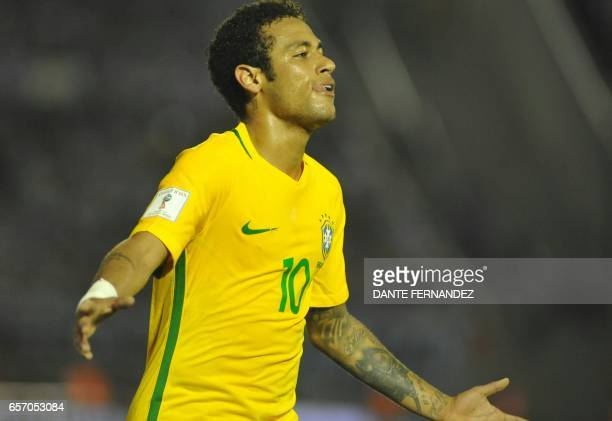 Brazil's Neymar celebrates his goal during their 2018 FIFA World Cup qualifier football match against Uruguay at the Centenario stadium in Montevideo...