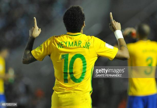 TOPSHOT Brazil's Neymar celebrates his goal during their 2018 FIFA World Cup qualifier football match against Uruguay at the Centenario stadium in...