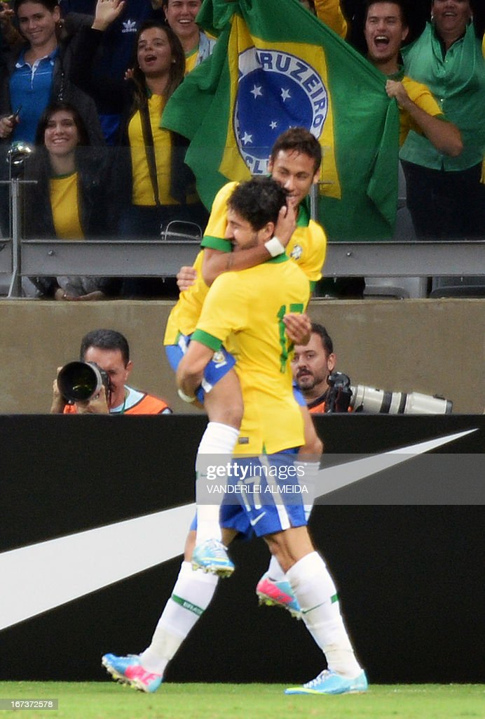 Brazil's Neymar celebrates with Alexandre Pato his second goal against Chile, during their friendly football match at the Mineirao stadium, in Belo Horizonte, Minas Gerais, Brazil, on April 24, 2013. AFP PHOTO /VANDERLEI ALMEIDA