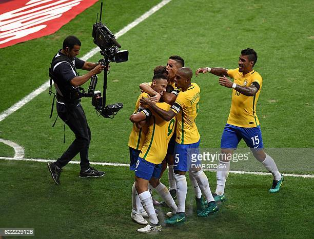 TOPSHOT Brazil's Neymar celebrates with teammates after scoring against Argentina during their 2018 FIFA World Cup qualifier football match in Belo...