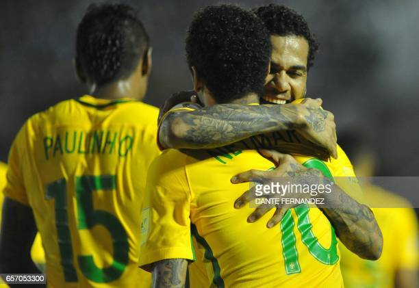 Brazil's Neymar celebrates with teammates his goal during their 2018 FIFA World Cup qualifier football match against Uruguay at the Centenario...