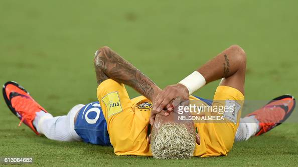 TOPSHOT Brazil's Neymar gestures on the ground after receiving an elbow to the face by Bolivia's Yasmani Duk during the Russia 2018 World Cup...