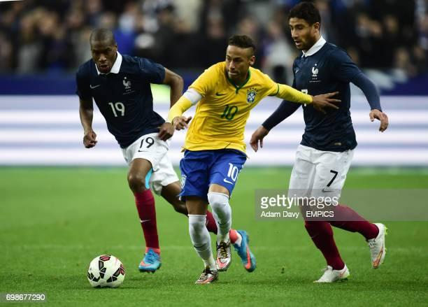 Brazil's Neymar gets away from France's Geoffrey Kondogbia and Nabil Fekir