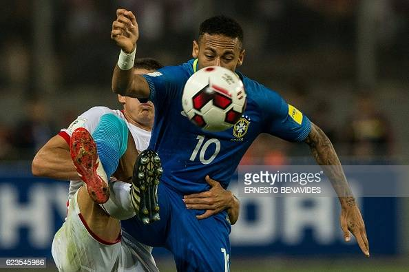 TOPSHOT Brazil's Neymar is grabbed by Peru's Aldo Corzo during their 2018 FIFA World Cup qualifier football match in Lima on November 15 2016 / AFP /...