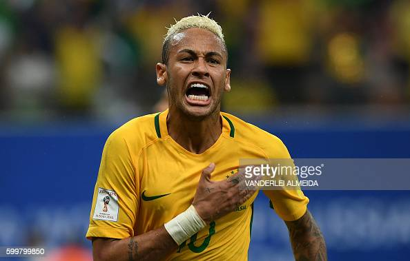 TOPSHOT Brazil's Neymar Jr celebrates after scoring against Colombia during their Russia 2018 FIFA World Cup football qualifier match Brazil vs...