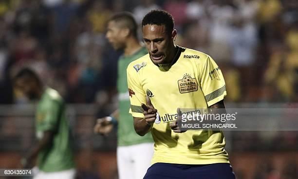 Brazil's Neymar of Spanish team Barcelona celebrates his goal during the charity football match Ousadia vs Pedalada at Pacaembu stadium in Sao Paulo...