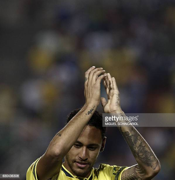 Brazil's Neymar of Spanish team Barcelona reacts during the charity football match Ousadia vs Pedalada at Pacaembu stadium in Sao Paulo on December...