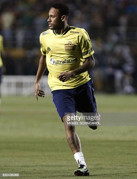 Brazil's Neymar of Spanish team Barcelona runs during the charity football match Ousadia vs Pedalada at Pacaembu stadium in Sao Paulo on December 22...