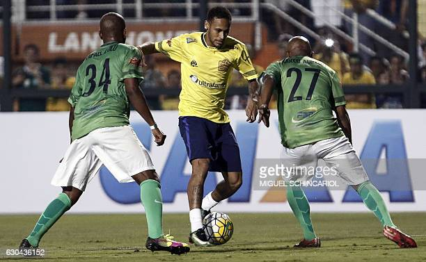 Brazil's Neymar of Spanish team Barcelona vies for the ball during the charity football match Ousadia vs Pedalada at Pacaembu stadium in Sao Paulo on...