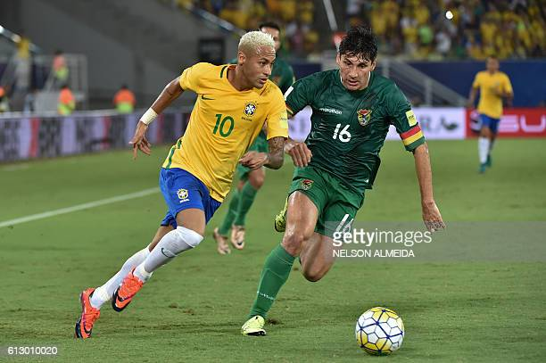 Brazil's Neymar vies for the ball with Bolivia's Ronald Raldes during their Russia 2018 World Cup qualifier football match in Natal Brazil on October...