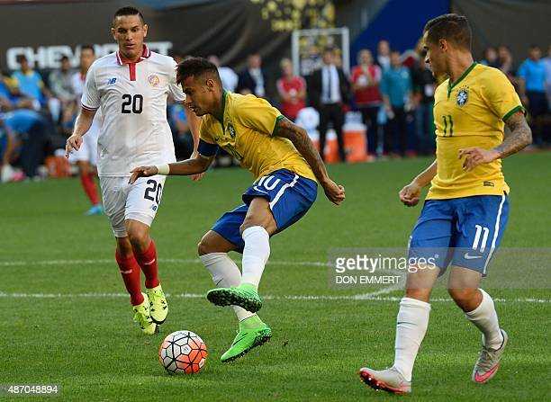 Brazil's Neymar works his way to the goal in front of Costa Rica's David Guzman as Brazil's Philippe Coutinho watches during the friendly match...