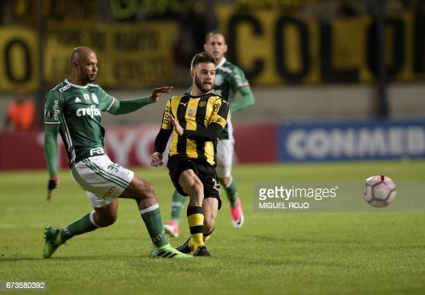 Brazil's Palmeiras Felipe Melo vies for the ball with Uruguay's Penarol Nahitan Nandez during their Libertadores Cup football match at the Campeones...