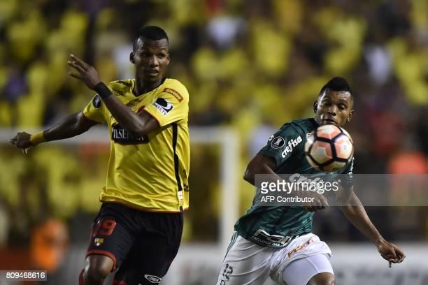 Brazil's Palmeiras Miguel Borja vies for the ball with Ecuador's Barcelona Dario Aimar during their 2017 Copa Libertadores football match at...