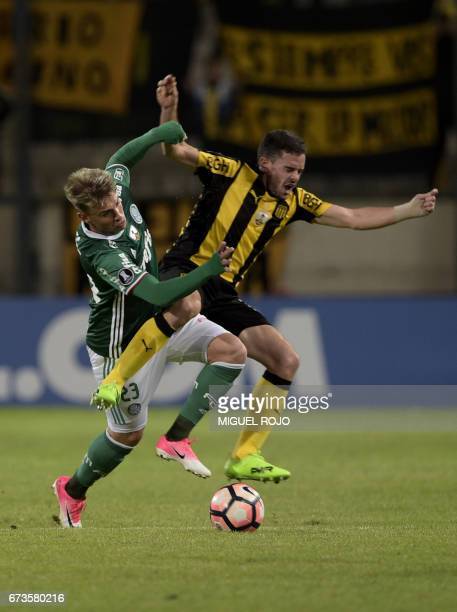Brazil's Palmeiras player Felipe Melo vies for the ball with Uruguay's Penarol Lucas Hernandez during their Libertadores Cup football match at the...
