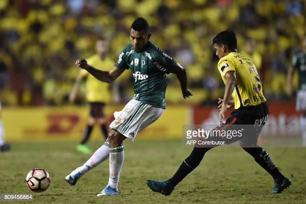 Brazil's Palmeiras player Miguel Borja vies for the ball with Xavier Arreaga of Ecuador's Barcelona during their 2017 Copa Libertadores football...