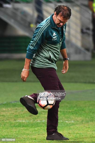 Brazil's Palmeiras team coach Cuca controls the ball during the 2017 Copa Libertadores football match against Argentina's Atletico Tucuman held at...