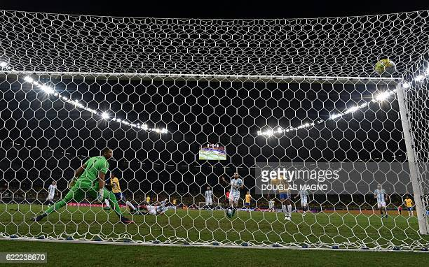 Brazil's Paulinho scores past Argentina's goalkeeper Sergio Romero during their 2018 FIFA World Cup qualifier football match in Belo Horizonte Brazil...