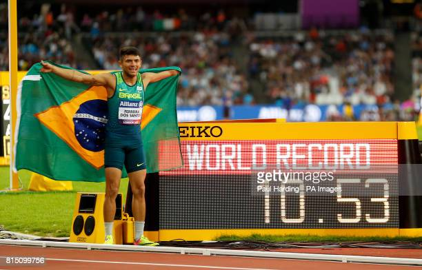 Brazil's Petrucio Ferreira dos Santos poses with the World Record board after winning the Men's 100m T47 Final during day two of the 2017 World Para...
