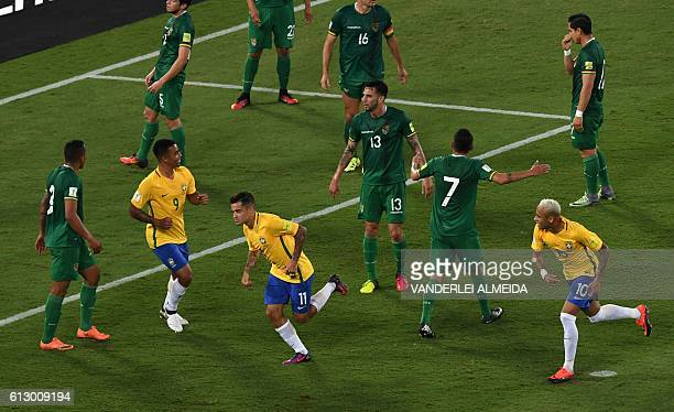 Brazil's Philippe Coutinho celebrates his goal against Bolivia with teammates Neymar and Gabriel Jesus during their Russia 2018 World Cup qualifier...