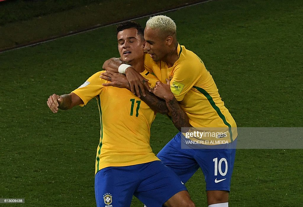 Brazil's Philippe Coutinho (L) celebrates his goal against Bolivia with teammate Neymar during their Russia 2018 World Cup qualifier football match in Natal, Brazil, on October 6, 2016. / AFP / VANDERLEI