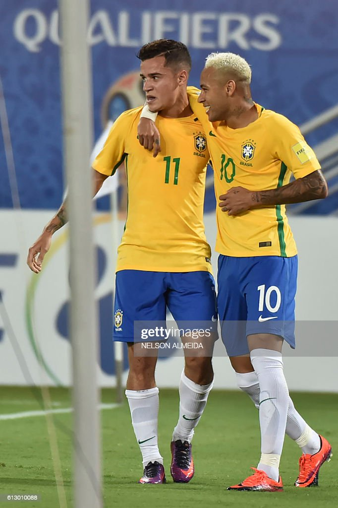 Brazil's Philippe Coutinho (L) celebrates his goal against Bolivia with teammate Neymar during their Russia 2018 World Cup qualifier football match in Natal, Brazil, on October 6, 2016. / AFP / Nelson ALMEIDA