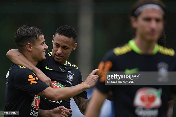 Brazil's Philippe Coutinho Neymar and Filipe Luis are pictured during a training session of the national football team at the Atletico Mineiro...