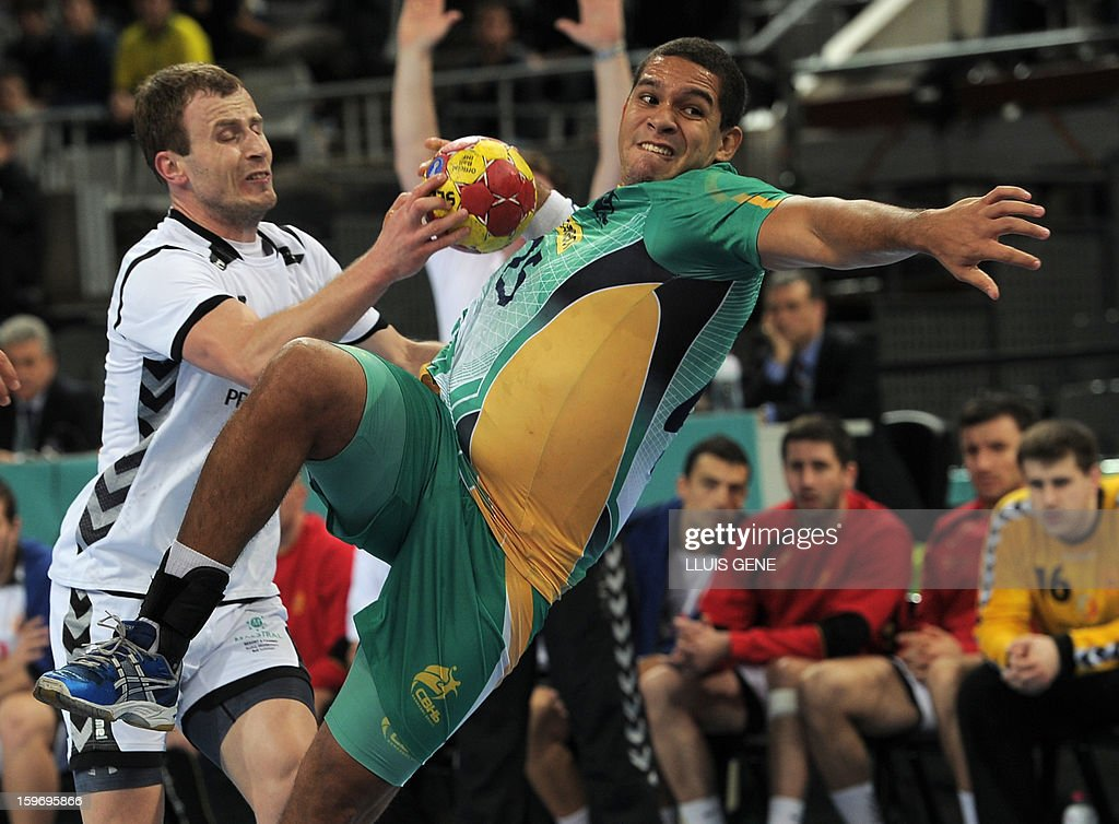 Brazil's pivot Vinicius Teixeira (R) vies with Montenegro's right wing Fahrudin Melic (L) during the 23rd Men's Handball World Championships preliminary round Group A match Montenegro vs Brazil at the Palau Sant Jordi in Barcelona on January 18, 2013.