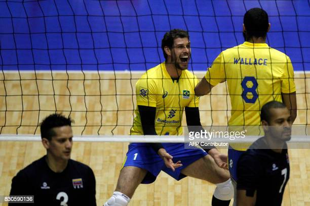 Brazil's player Bruno Rezende celebrates a point over Venezuela during their Men's South American Volleyball Championship final in Santiago on August...
