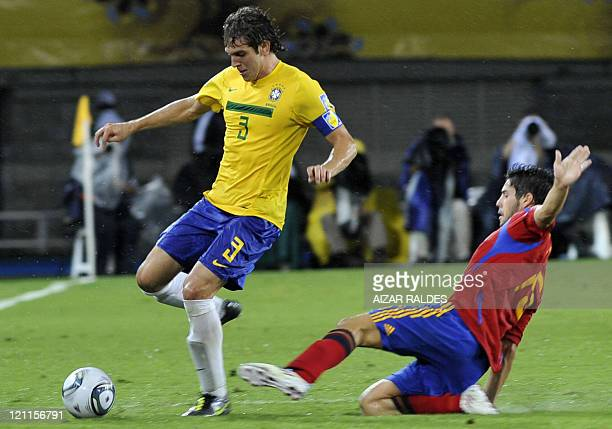 Brazil's player Bruno Uvini vies for the ball with Carles Planas from Spain during their FIFA U20 World Cup football match at the Hernan Ramirez...