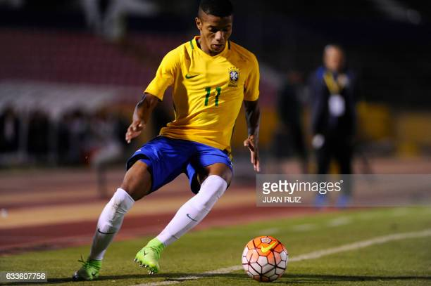 Brazil's player David Neres controls the ball during their South American Championship U20 football match against Uruguay in the Olimpico Atahualpa...