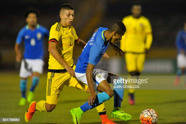 Brazil`s player David Neres vies for the ball with Colombia`s Juan Pablo Ramírez during their South American Championship U20 football match at the...