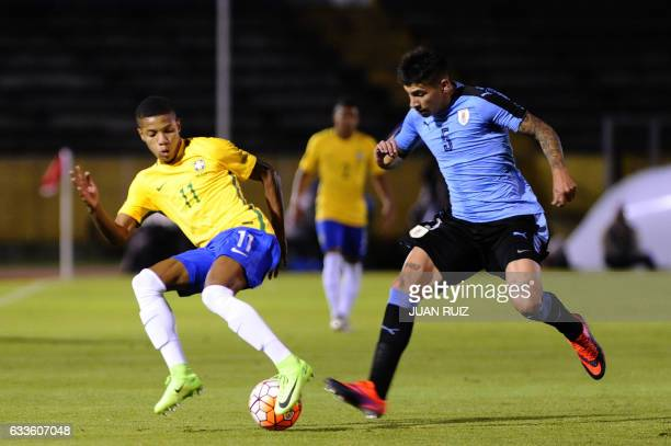 Brazil's player David Neres vies for the ball with Uruguay's player Matias Olivera during their South American Championship U20 football match in the...