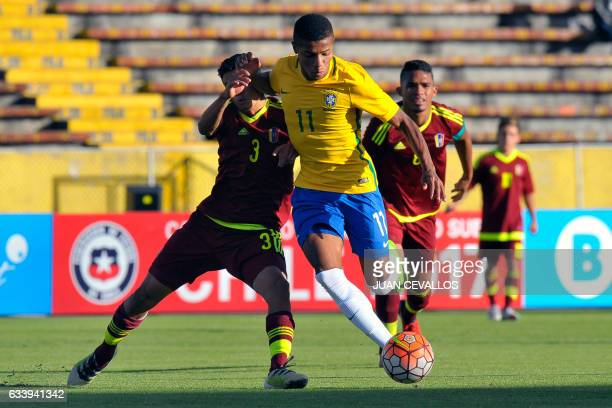 Brazil's player David Neres vies for the ball with Venezuela's player Edwin Quero during their South American Championship U20 football match at the...