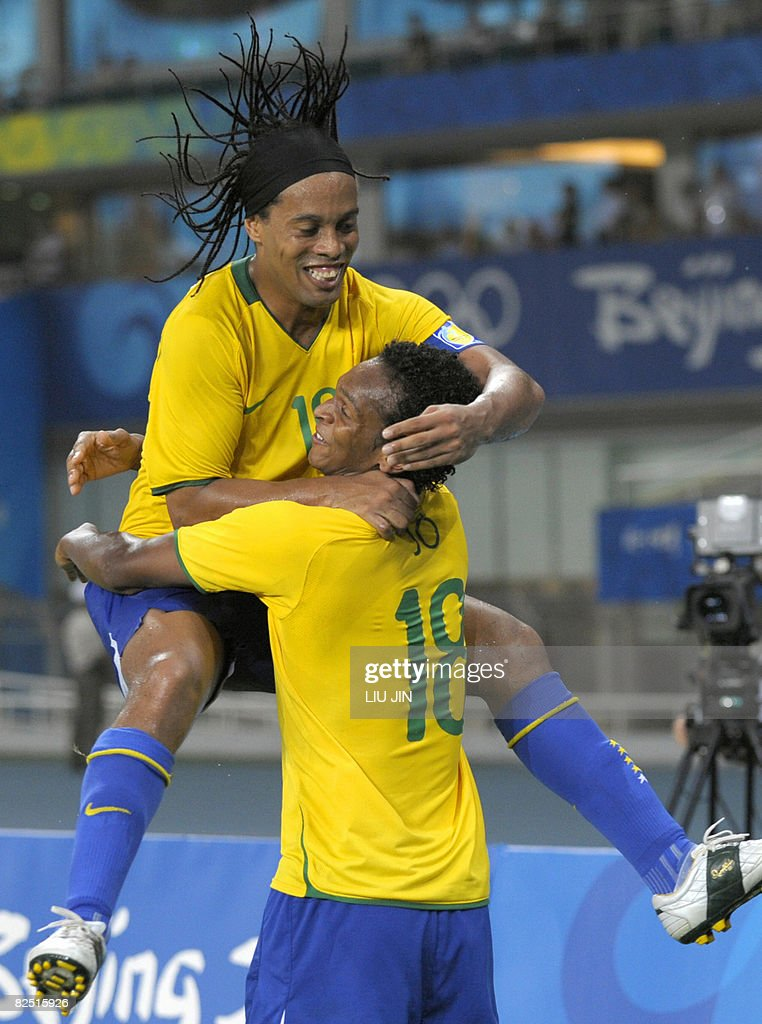 Brazil's player Jo (Back Facing) is congratulated by his team-mate Ronaldinho (Top) after he scored the third goal against Belgium during the 2008 Beijing Olympic Games men's football bronze medal match at the Shanghai Stadium on August 22, 2008. Brazil defeated Belgium 3-0. AFP PHOTO/LIU Jin