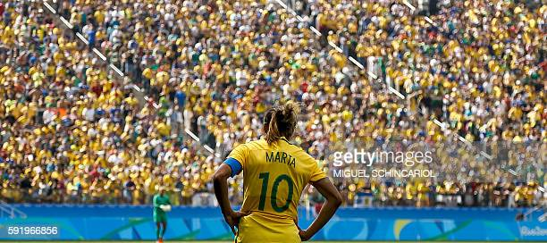 TOPSHOT Brazil's player Marta reacts during their Rio 2016 Olympic Games women's bronze medal football match between Brazil vs Canada at the Arena...