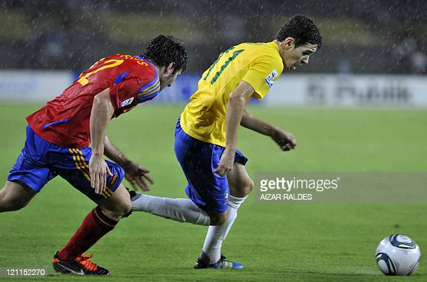 Brazil's player Oscar Dos Santos vies for the ball with Carles Planas from Spain during their FIFA U20 World Cup football match at the Hernan Ramirez...