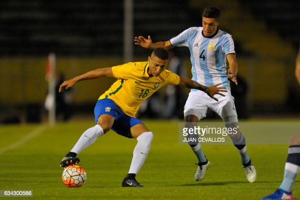 Brazil`s player Richarlison vies for the ball with Argentina`s player Nahuel Molina Lucero during their U20 South American Championship football...