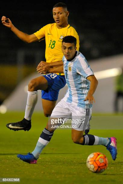 Brazil's player Richarlison vies for the ball with Argentina`s player Lucas Rodríguez during a South American Championship U20 football match at the...