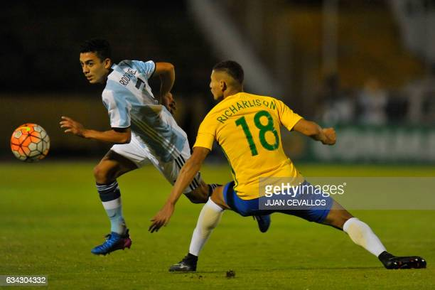 Brazil`s player Richarlison vies for the ball with Argentina`s player Lucas Rodriguez during their South American Championship U20 football match in...